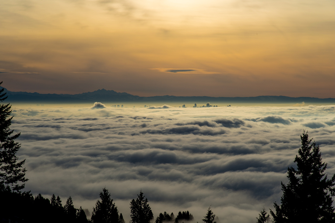 sunset over the fog in vancouver looking over metrotown